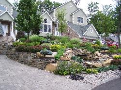 Natural Stone Retaining wall, paver driveway, steps, water feature